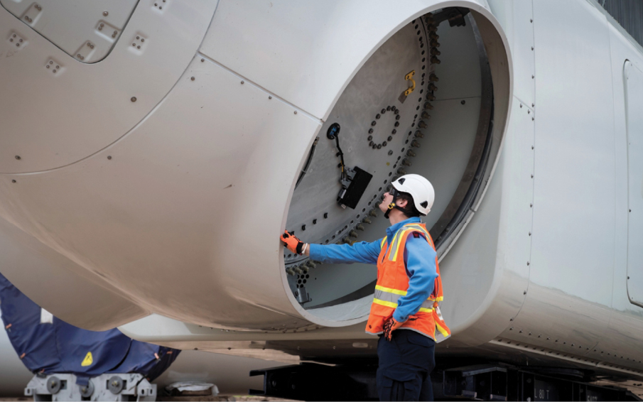 Wind technician, Jacob Madsen inspecting nacelle at Los Vientos wind farm in Lyford, Texas. Credit: Duke Energy.