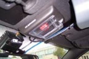 A manual deployment switch is located between the front sun visors. It indicates the option is present.