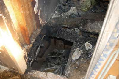 (3) The hole created when Firefighter Hakopian fell through the floor.
