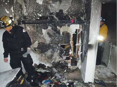 (4) Fire issued from this closet in the room where the child was discovered.