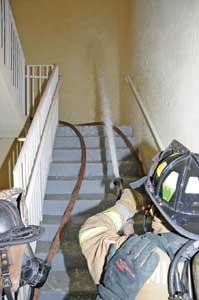 (13) The nozzle is flowed before opening the stairwell door to the fire floor.