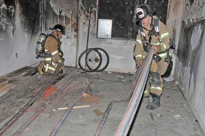 (30) Hose is laid out in an adjoining apartment. The door is kept closed to keep it clear of smoke.