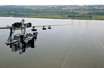 Hydro-Quebec developed the Line-Scout robot, shown here, to carry out line inspections that otherwise would have to be done by helicopter.