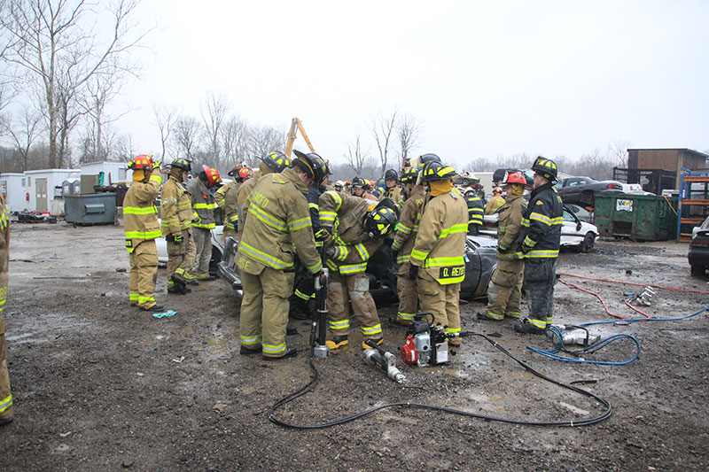 Firefighters participate in vehicle extrication training at FDIC 2014.