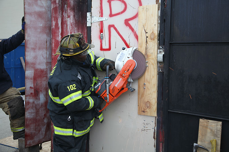 A firefighter trains on cutting at FDIC 2014.