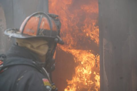 Firefighters train in a flashover simulator.