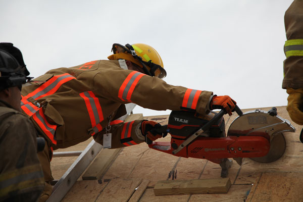 Firefighter training roof cuts at FDIC 2014.