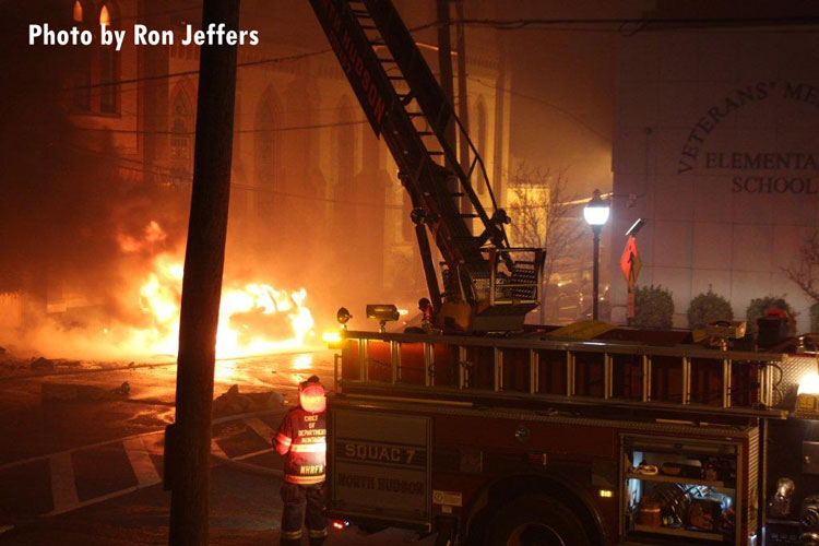 Flames engulf a vehicle during a multi-alarm fire in Union City, New Jersey.