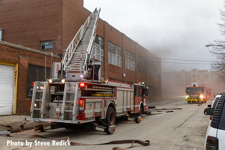 Chicago fire apparatus parked at the scene of a fire at an abandoned industrial site.