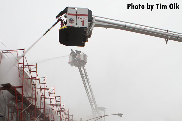 Firefighters in aerial devices put water on a warehouse fire in Chicago