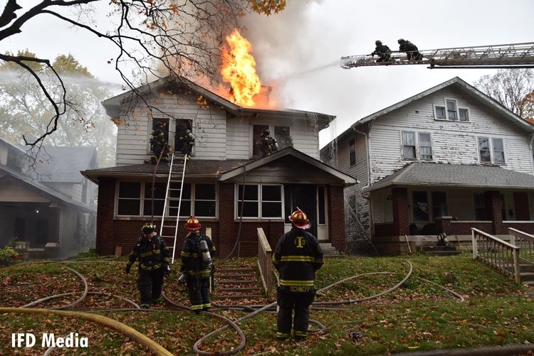 Indy firefighters battle fire in a double residence