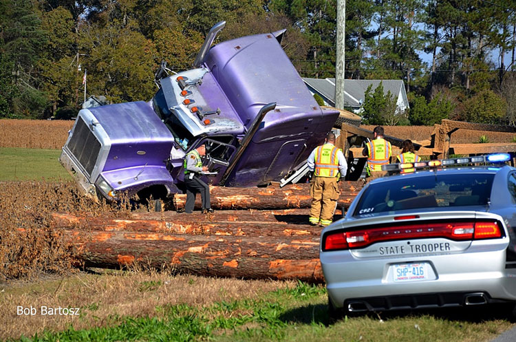 Firefighters Respond To Large Log Truck Vs Car Accident In Nash