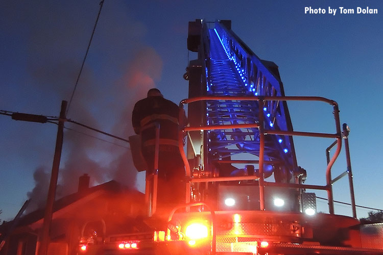 Indianapolis firefighter on turntable of apparatus