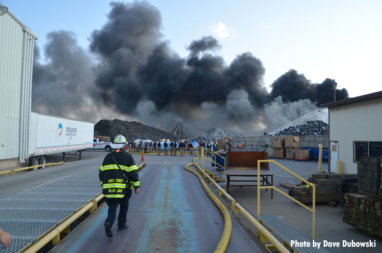 Firefighter at recycling plant fire