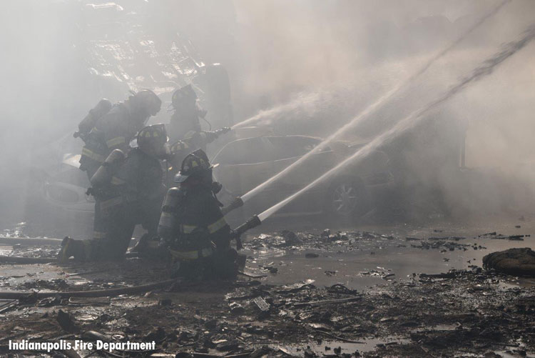 Firefighters at salvage yard fire