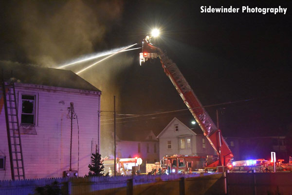 Aerial device in use at a structure fire in Watervliet, New York.