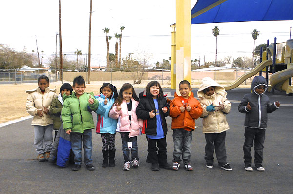 Professional Fire Fighters of Nevada Donate Over 300 Coats as Part of 2013 'Coats for Kids Campaign