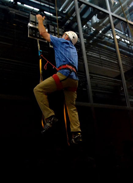 During testing, an operator climbed 25 feet vertically on a glass surface using no climbing equipment other than a pair of hand-held, gecko -inspired paddles.