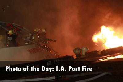 Firefighters battle flames at the port of Los Angeles.