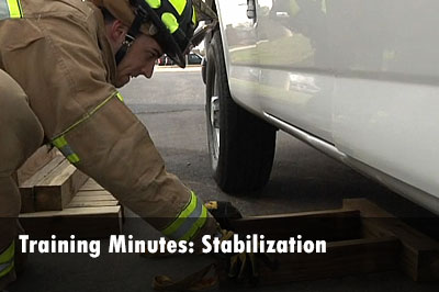 Demonstration of box crib use for stabilizing vehicles.