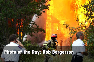 Firefighters operate at the scene of a blazing fire. By Rob Bergerson.
