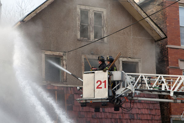 Firefighters in an aerial at fire scene.