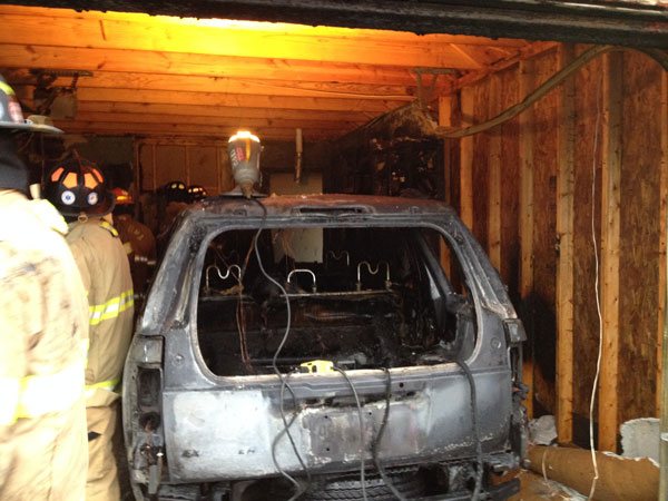 A view of one of the vehicles burned in the garage.