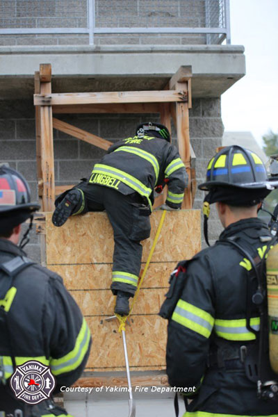 Firefighters practice window entry techniques. Courtesy Yakima Fire Department.