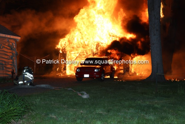 Firefighters at the scene of a fully involved garage fire in Manchester, Connecticut.