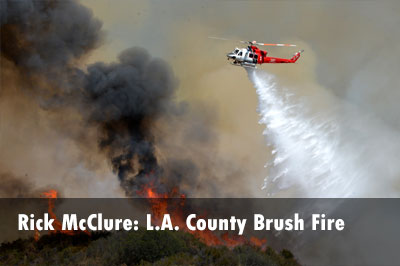 Helicopter drops water on Santa Clarita (CA) brush fire.