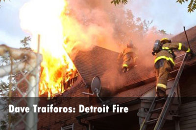 Firefighters on roof at Detroit house fire