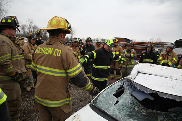 Firefighters listen during an extrication training evolution.