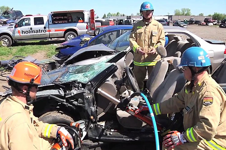 Todd Taylor and other firefighters demonstrate an extrication technique on a vehicle