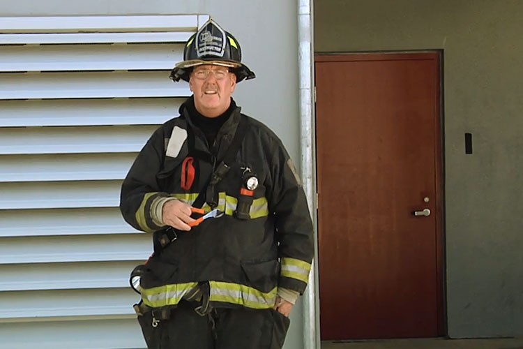 John Simpson with firefighting tools