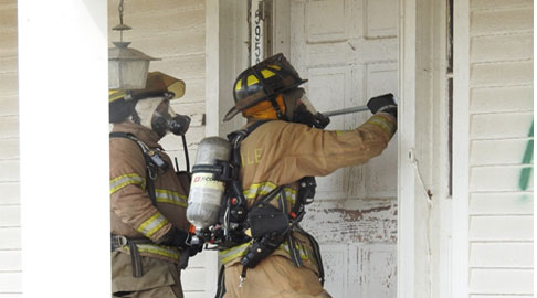 Firefighters force entry during drill