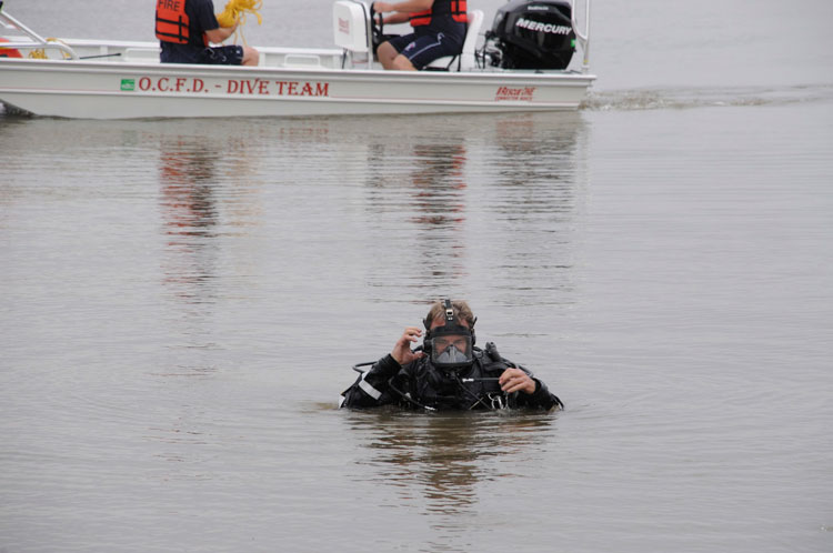A fire department diver undertakes dive operations