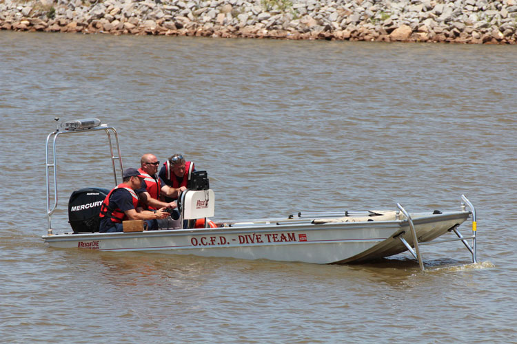 Dive team members on a boat