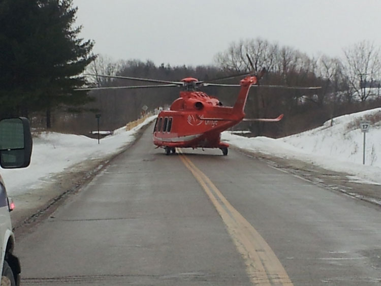 An air ambulance helicopter arrives at an emergency scene