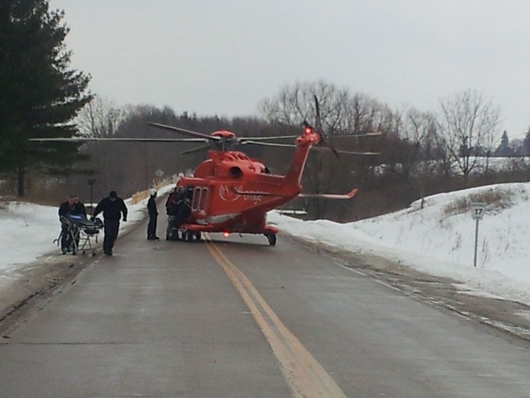 Crew members escort responders to helicopter