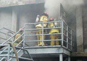 (1) Live fire training at the Class A burn building. (<i>Photo courtesy of VBFA.</i>)