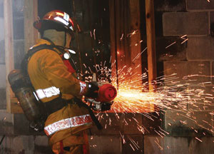 (3) A Shift Day participant performs forcible entry. (<i>Photo by Rayford Smith.</i>)