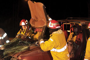(5) A crew practices vehicle rescue operations. (<i>Photo by Rayford Smith.</i>)