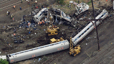 An aerial view of the derailment shows the large area over which it extended, requiring that the scene be split into two manageable geographic divisions