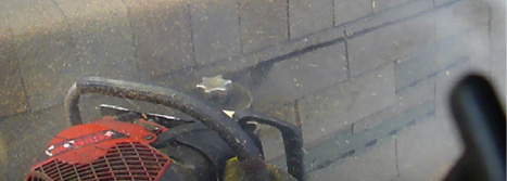 (1) A fire service chain saw with a depth guard is used to vent a peaked roof. (Photos by author.)