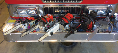 (2) Shown are five chain saw options for fire service use: (from left to right) small arbor chain saw with chipping blade, heavy duty chain saw with carbide-tipped blade, chain saw with blade depth guard and carbide-chipping blade, chain saw with blade depth guard and bullet blade, and specialized concrete-cutting chain saw with diamond blade.