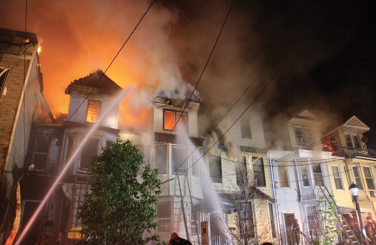 (3) Multiple strategic modes are in place at this incident. As the fire spreads toward the buildings on the D side, more aggressive interior operations (interior defensive) must take place to keep the fire confined to its present location and stop the spread. At this point, these buildings should all have been searched and evacuated, so the life focus now becomes one of firefighter safety, and the strategic focus centers on limiting damage.