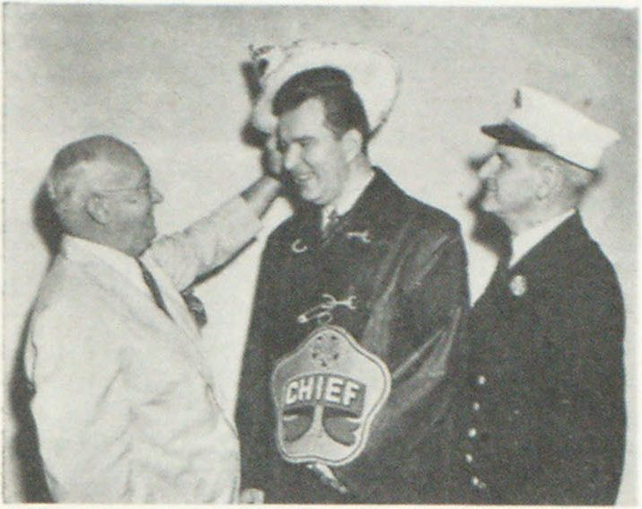 And Now It's Chief Fenchen of the Hotel Pennsylvania John A. Fenchen. Sales Manager of Hotel Pennsylvania, is shown above being inducted as a Junior Chief upon the occasion of the convention of the Eastern Association of Fire Chiefs, recently held at the Hotel Pennsylvania. Charley Clark. Secretary of the Eastern Association. places the hat on John Fenchen's head as Deputy Chief John J. T. Waldron of New York looks on.