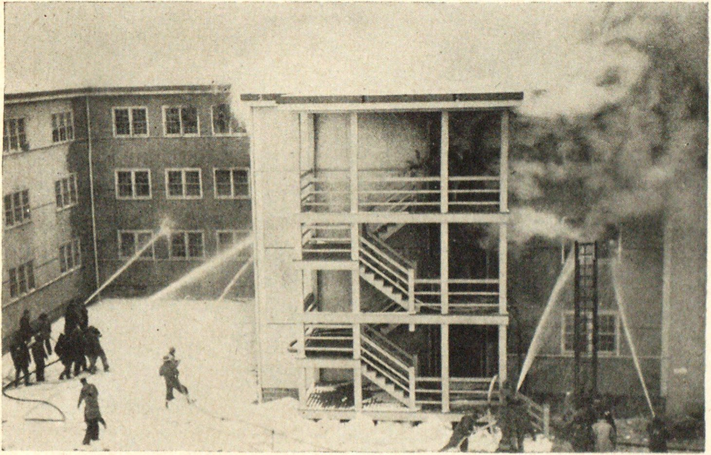 View Showing East Section of Typhoon Dormitory. Fire Started in Room on Second Floor at Right into which Two Streams Are Directed.