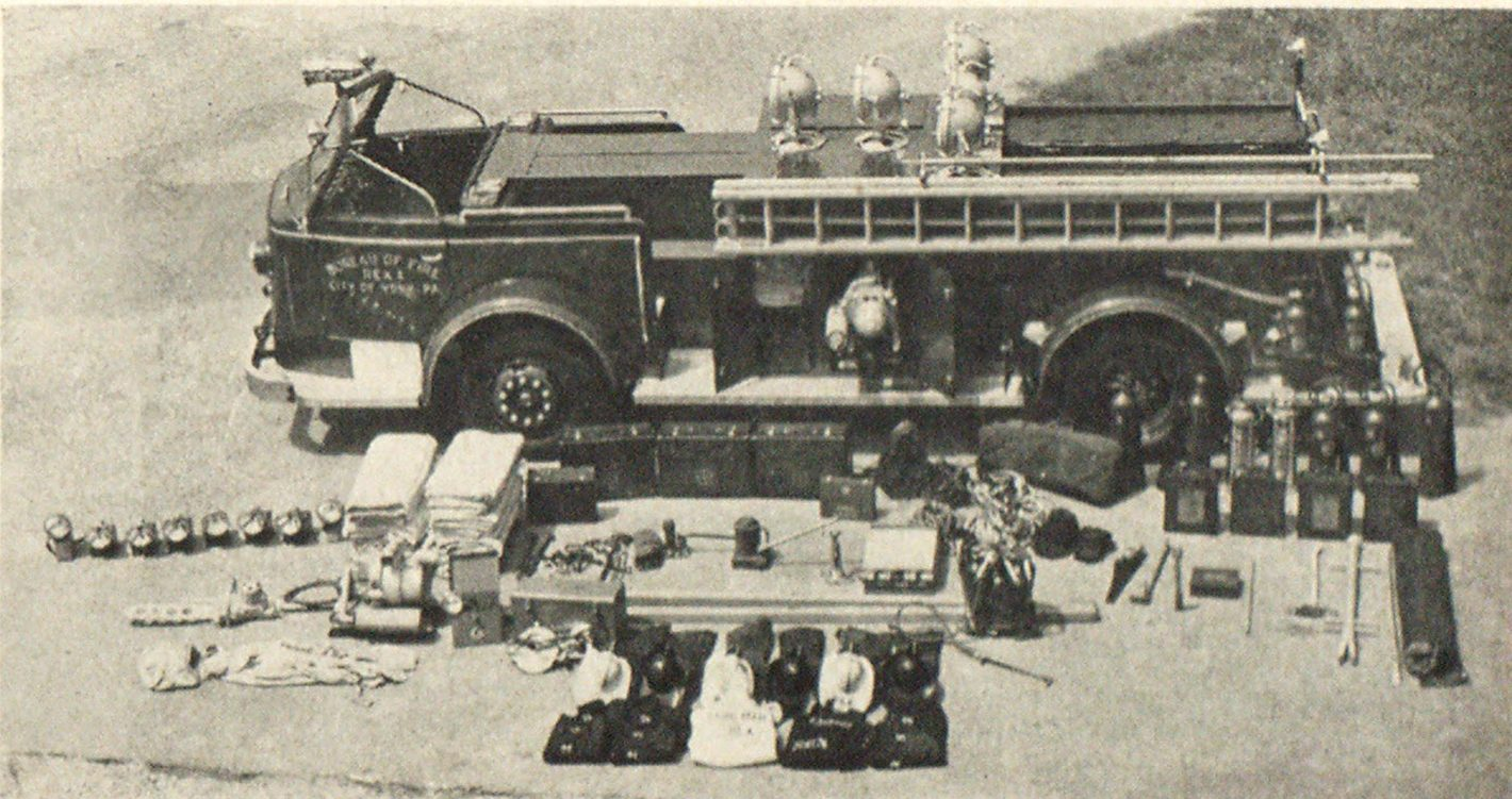 The York, Pa., rescue unit packs plenty of punch and equipment. Recently delivered rescue truck (Rex 1) has compartment space for most basic rescue and first aid equipment. York preferred the open to the enclosed cab type. Note the range of equipment.