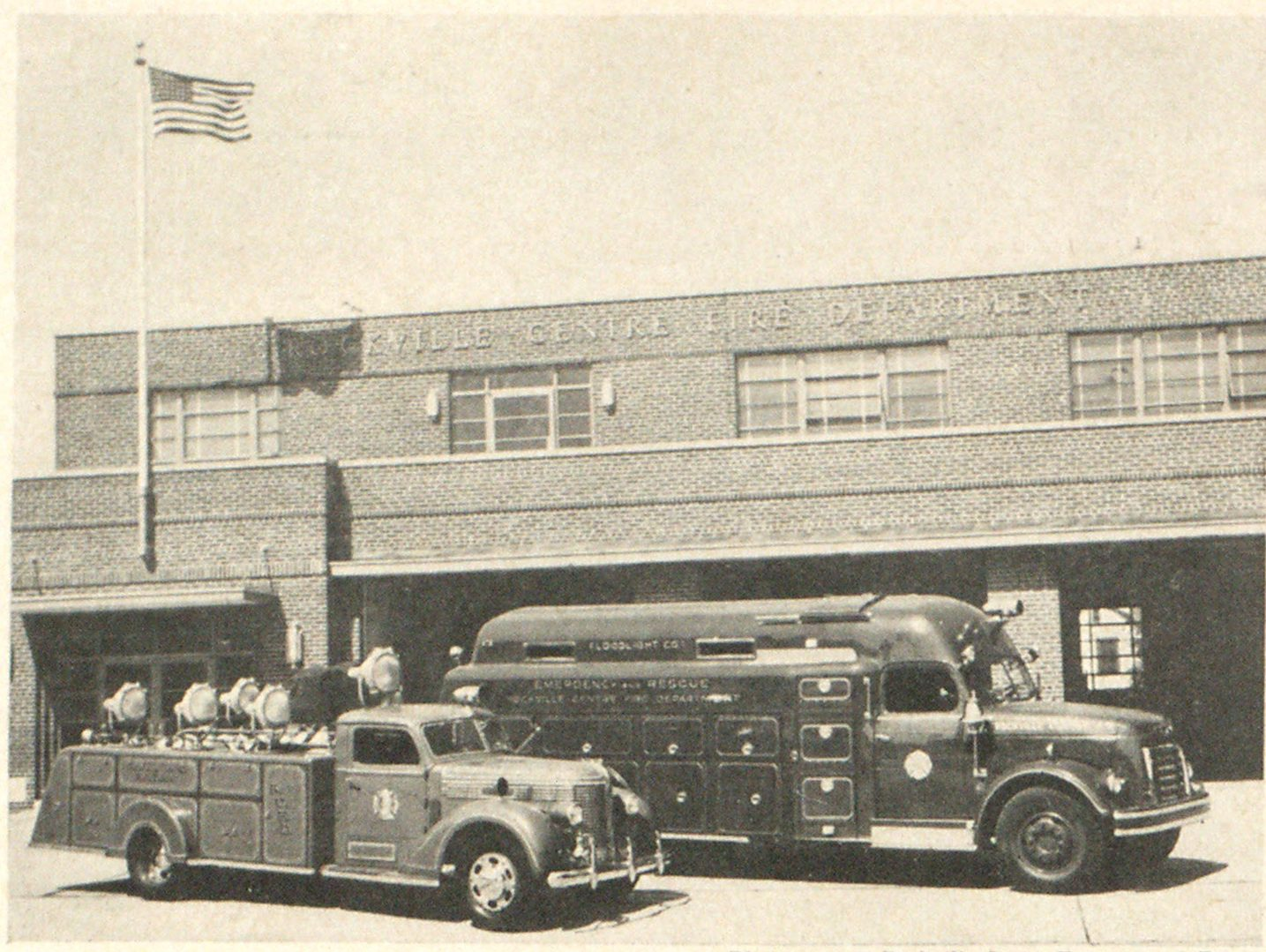 The first Emergency and Floodlight of the Rockville Centre, L. I., Fire Department, vintage 1940, alongside the recently installed streamlin ed unit in front of the department's attractive fire house. New truck is known as Emergency and Rescue Floodlight Co. No. I. Its captain is R. W. Boggs.